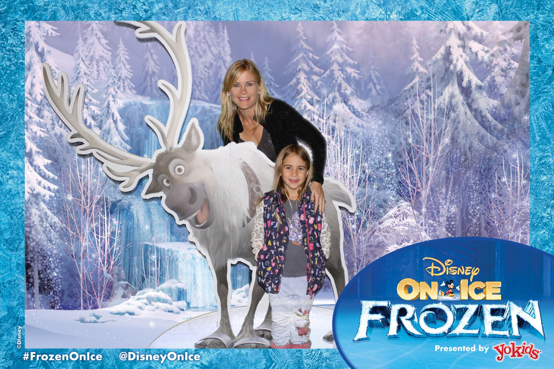 Holiday Event Photography, mother and daughter posing with sven in front of a green screen photography background against an ice forest at the Staples Center in Los Angeles, CA